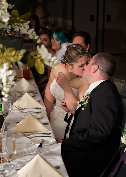 Kissing at reception table.jpg