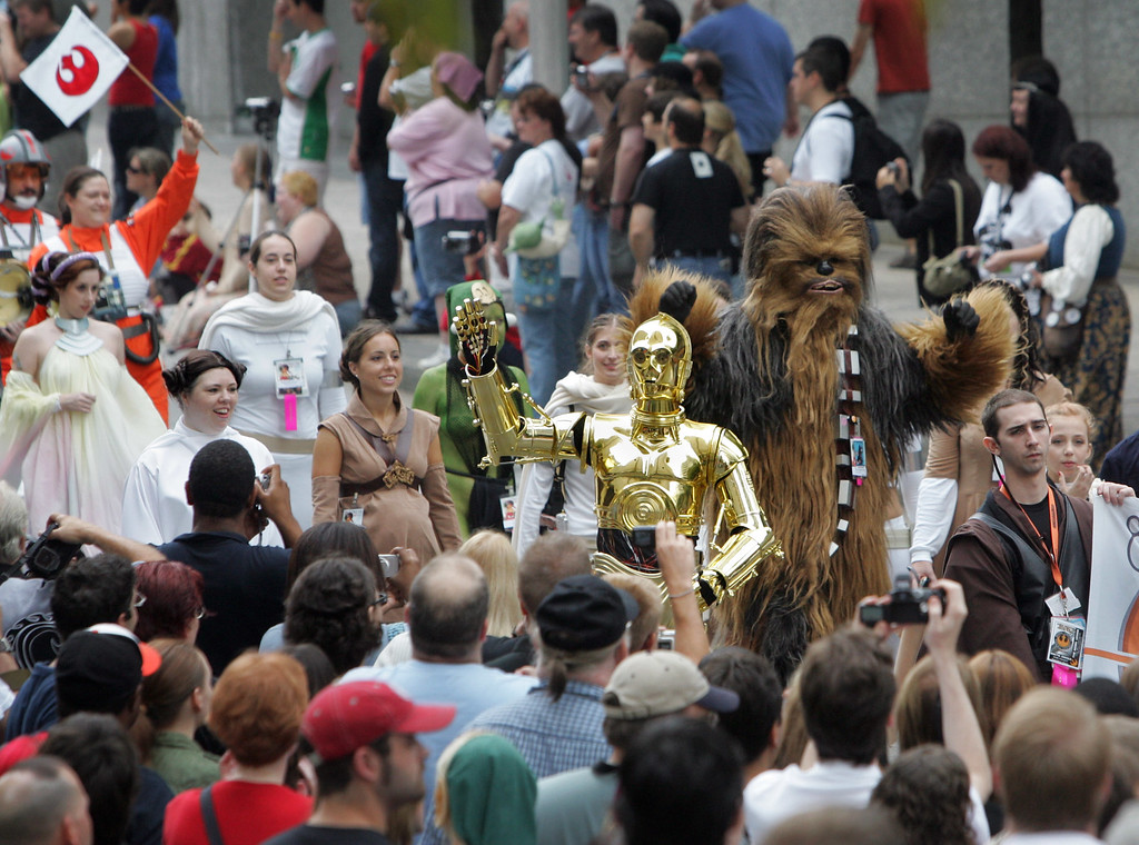. Sci-fi enthusiasts dressed as Star Wars characters march past onlookers during the Dragon-Con Parade through downtown Atlanta, Saturday, Sept. 2, 2006. (AP Photo/John Amis)