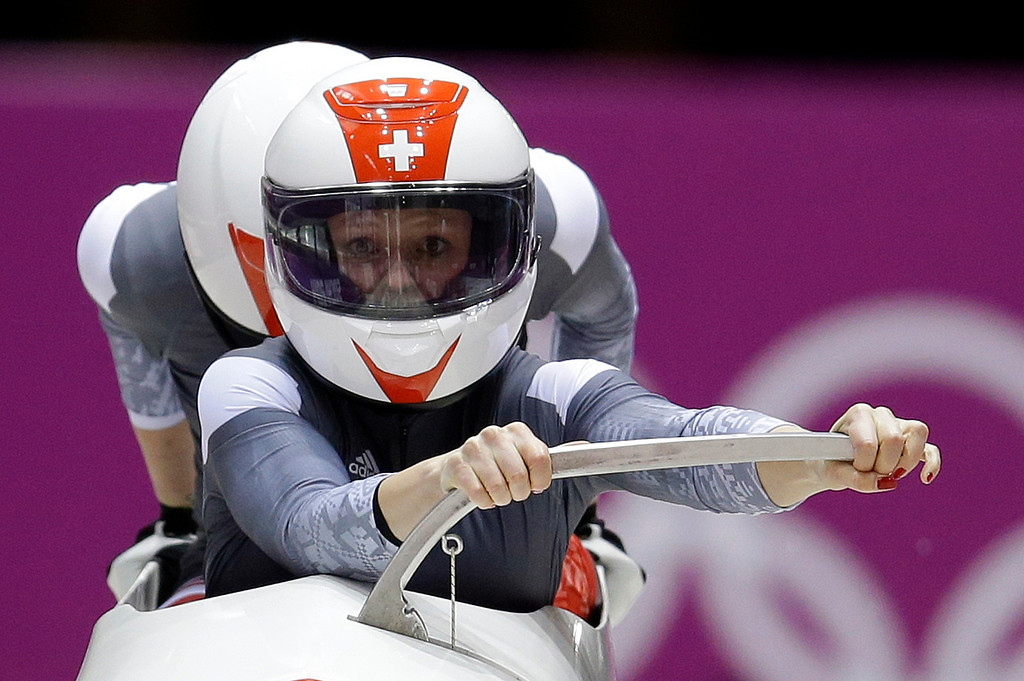 . The team from Switzerland SUI-1, piloted Fabienne Meyer with brakeman Tanja Mayer, starts their first run during the women\'s two-man bobsled competition at the 2014 Winter Olympics, Tuesday, Feb. 18, 2014, in Krasnaya Polyana, Russia. (AP Photo/Natacha Pisarenko)