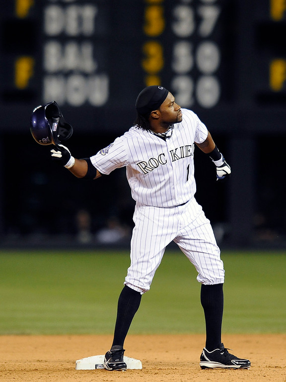 . Colorado Rockies Eric Young Jr. throws his helmet after flying out to end the inning in the eleventh inning of a baseball game against the San Diego Padres on Thursday, June 6, 2013 in Denver. The Padres won 6-5 in 12 innings. (AP Photo/Chris Schneider)