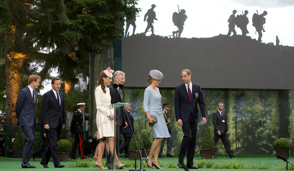 . From left, Britain\'s Prince Harry, British Prime Minister David Cameron, Kate, Duchess of Cambridge, Belgium\'s King Philippe, Belgium\'s Queen Mathilde and Britain\'s Prince William attend a commemoration ceremony to mark the 100th anniversary of the outbreak of World War I at the St. Symphorien Cemetery in St. Symphorien, Belgium on Monday, Aug. 4, 2014. The cemetery was established by the German Army as a final resting place for British and German soldiers killed at the Battle of Mons. Among those buried is Pvt. John Parr of the Middlesex Regiment, the first British soldier to be killed in action on the Western Front. (AP Photo/Virginia Mayo)