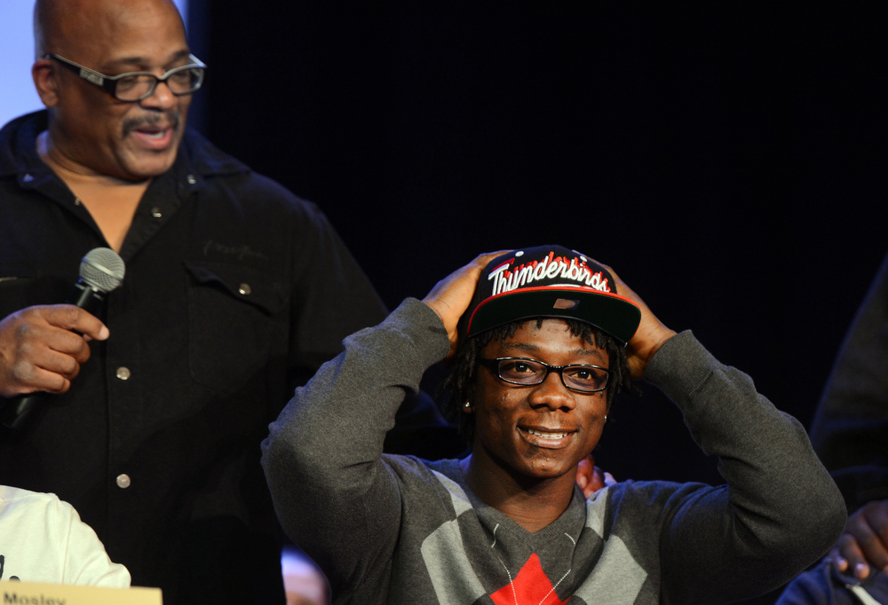 . Denver South High School football coach Tony Lindsay Sr. introduces player Pete Williams during a signing day ceremony at the school in Denver, CO February  06, 2013. Williams signed with Southern Utah University. (Photo By Craig F. Walker/The Denver Post)