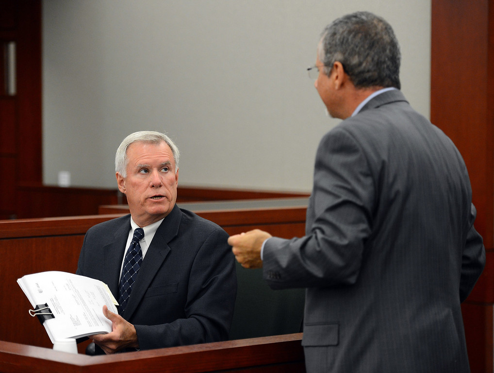. Former Clark County Chief Deputy District Attorney and O.J. Simpson trial prosecutor Chris Owens is questioned by Simpson defense attorney Ozzie Fumo during an evidentiary hearing for Simpson in Clark County District Court on Tuesday, May 14, 2013 in Las Vegas.  The hearing is aimed at proving Simpson\'s trial lawyer, Yale Galanter, had conflicted interests and shouldn\'t have handled Simpson\'s case. Simpson is serving nine to 33 years in prison for his 2008 conviction in the armed robbery of two sports memorabilia dealers in a Las Vegas hotel room. (AP Photo/Ethan Miller, Pool)