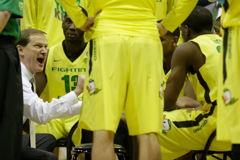 . Oregon head coach Dana Altman talks to his team during a timeout during the second half of a second-round game against the BYU in the NCAA college basketball tournament Thursday, March 20, 2014, in Milwaukee. Oregon won 87-68. (AP Photo/Morry Gash)