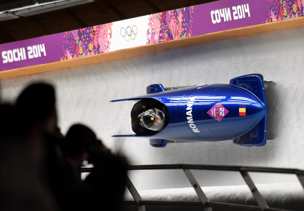 . Romania-1 two-man bobsleigh steered by Nicolae Istrate races in the Bobsleigh Two-man, Heat 2 at the Sanki Sliding Center in Rosa Khutor during the Sochi Winter Olympics on February 16, 2014.   LEON NEAL/AFP/Getty Images
