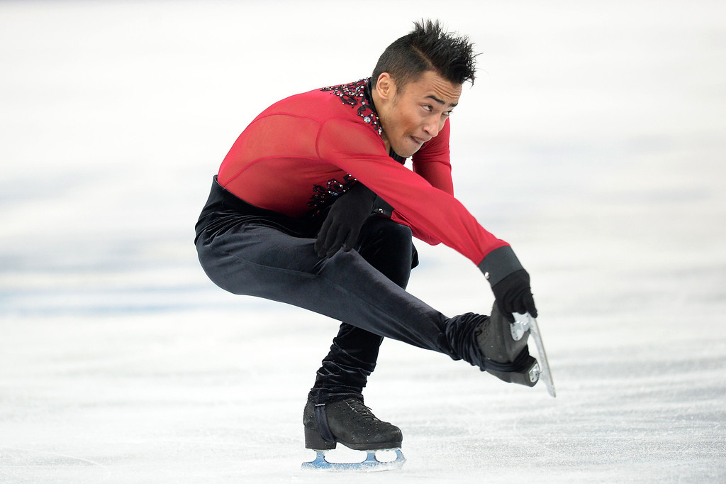 . France\'s Florent Amodio performs during the Men\'s Figure Skating Short Program at the Iceberg Skating Palace during the Sochi Winter Olympics on February 13, 2014.  YURI KADOBNOV/AFP/Getty Images