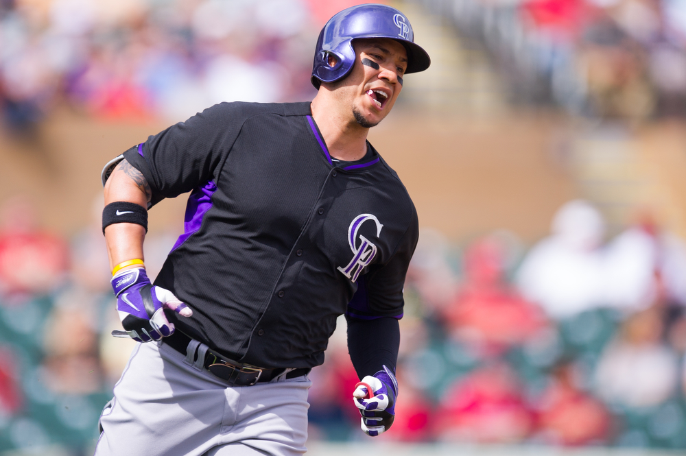 . Carlos Gonzalez #5 of the Colorado Rockies runs the bases during a spring training game against the Arizona Diamondbacks at Salt River Fields at Talking Stick on February 28, 2014 in Scottsdale, Arizona. (Photo by Rob Tringali/Getty Images)