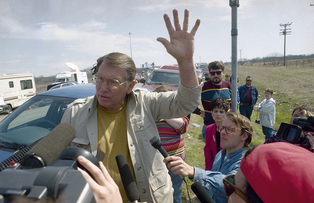 . Talking to a crowd of reporters near the Branch Davidian compound, Pastor W.N. Otwell questions the motives of federal authorities who said they were concerned about the safety of women and children in the compound near Waco, Texas on Saturday, March 6, 1993. Otwell is from the God Said Ministries in Nacogdoches, Texas. (AP Photo/John Gaps III)