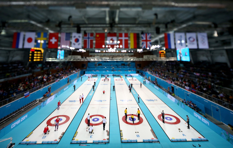 . (EDITORS NOTE: Image was created using a variable planed lens) A general view of the action in the men\'s round robin session during day four of the Sochi 2014 Winter Olympics at Ice Cube Curling Center on February 11, 2014 in Sochi, Russia.  (Photo by Streeter Lecka/Getty Images)