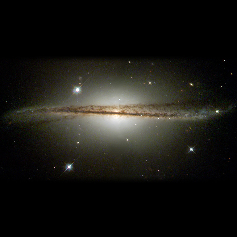 . 2001: Warped Edge-On Galaxy ESO 510-G13  NASA\'s Hubble Space Telescope has captured an image of an unusual edge-on galaxy, revealing remarkable details of its warped dusty disk and showing how colliding galaxies spawn the formation of new generations of stars.  The dust and spiral arms of normal spiral galaxies, like our own Milky Way, appear flat when viewed edge-on. This month\'s Hubble Heritage image of ESO 510-G13 shows a galaxy that, by contrast, has an unusual twisted disk structure, first seen in ground-based photographs obtained at the European Southern Observatory (ESO) in Chile. ESO 510-G13 lies in the southern constellation Hydra, roughly 150 million light-years from Earth. Image Credit: NASA and The Hubble Heritage Team (STScI/AURA), Acknowledgment: C. Conselice (U. Wisconsin/STScI)