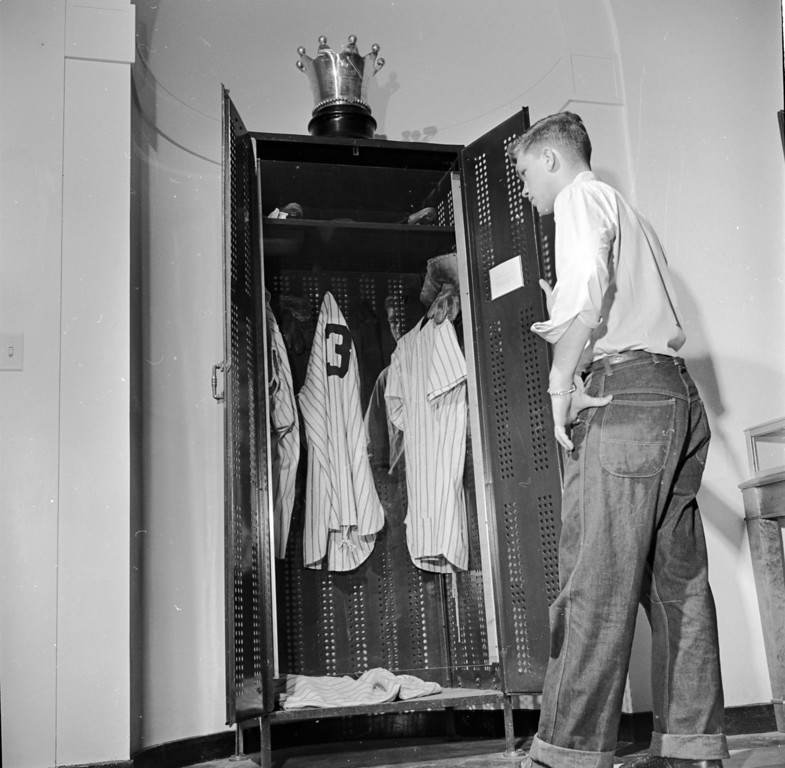 . circa 1955:  A visitor viewing the locker used by American baseball player Babe Ruth, topped with a silver crown trophy at Cooperstown Baseball Hall of Fame and Museum, New York.  (Photo by Three Lions/Getty Images)