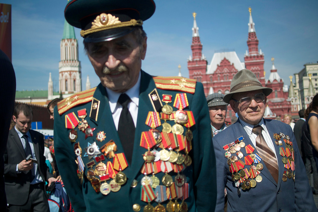 . Russian WWII veterans walk after the Victory Day parade at Red Square on Thursday, May 9, 2013. Russian President Vladimir Putin said at the annual military parade hat Russia will be a guarantor of world security. Putin\'s short speech came at the culmination of Victory Day, marking the defeat of Nazi Germany 68 years ago. It is Russia\'s most important secular holiday, honoring the huge military and civilian losses of World War II and showing off the country\'s modern arsenal. (AP Photo/Ivan Sekretarev)