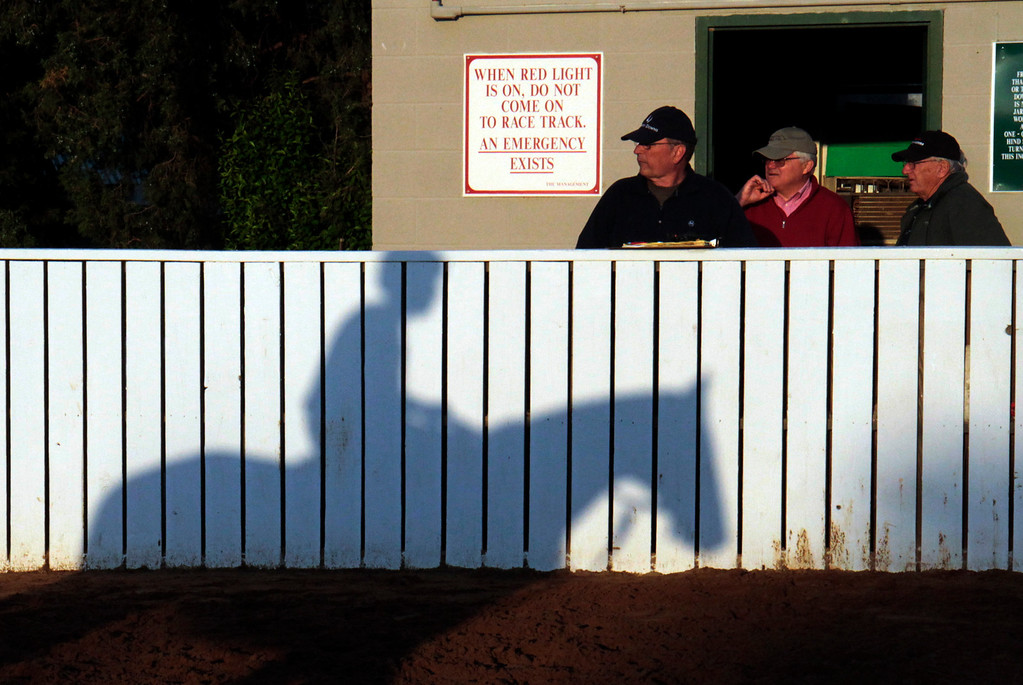 . People watch as horses take to the track for a morning workout at Churchill Downs Wednesday, May 1, 2013, in Louisville, Ky. (AP Photo/Garry Jones)