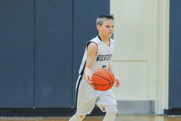 7th grade boys basketball action
