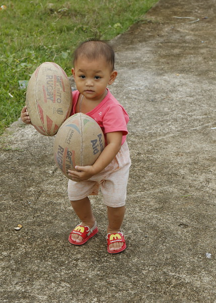 Future star in the making - two Rugby Footballs -