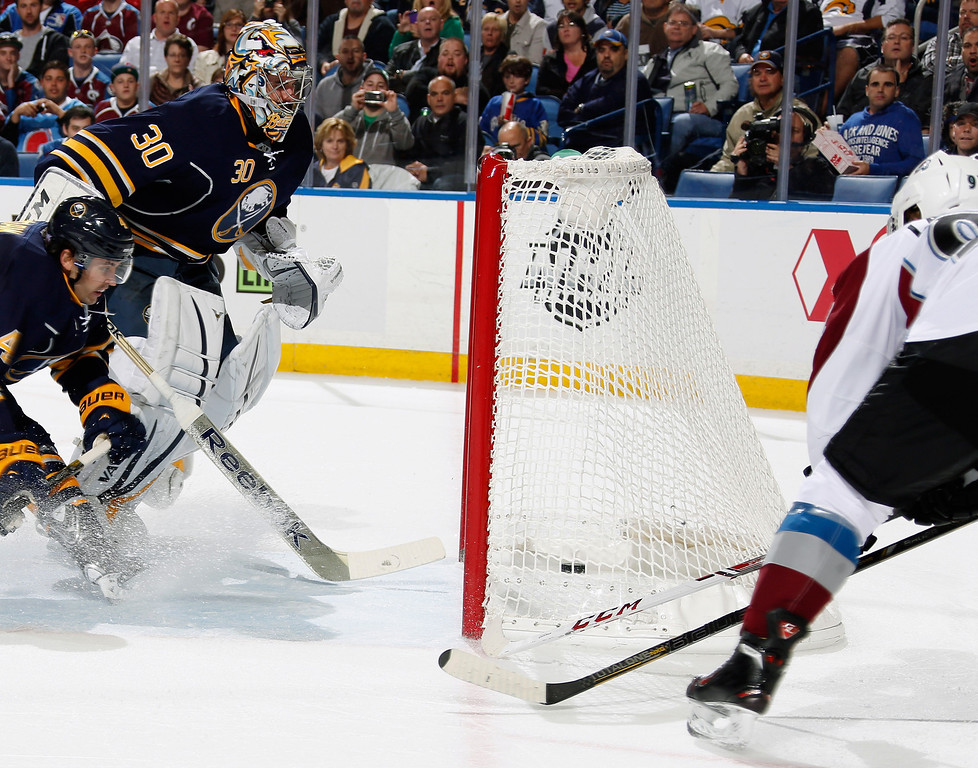 . BUFFALO, NY - OCTOBER 19:  Gabriel Landeskog #92 of the Colorado Avalanche scores past Ryan Miller #30 of the Buffalo Sabres at First Niagara Center on October 19, 2013 in Buffalo, New York.  (Photo by Jen Fuller/Getty Images)