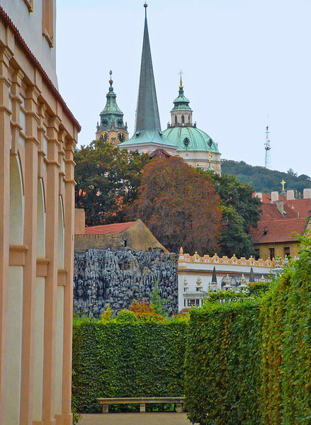 Wallenstein Palace and gardens. A sculpted wall of stalagmites and stalactites at the end.