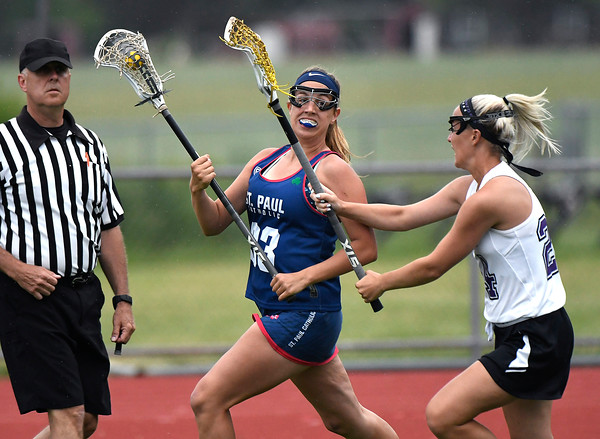 5/31/2018 Mike Orazzi | Staff St. Paul Catholic High School's Ashley Suzio (33) and North Branford High School's Adriana Ingarra (24) during the girls Class S Quarterfinals lacrosse at North Branford High School Thursday evening.
