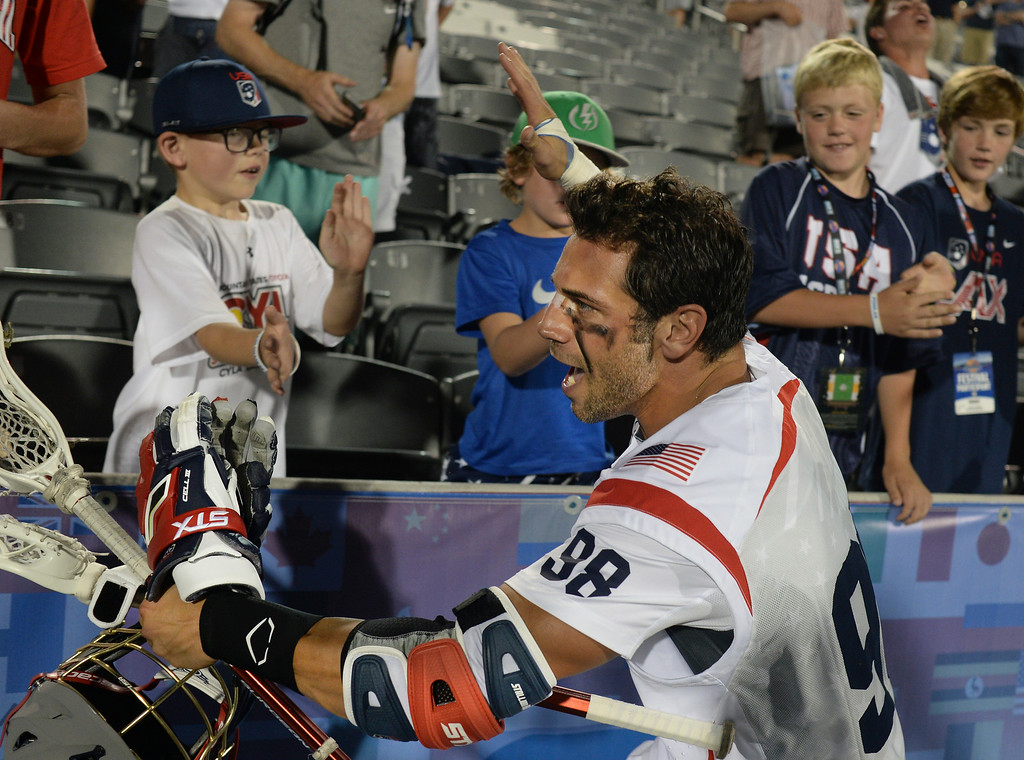 . United States midfielder Greg Gurenlian celebrated the win with fans. The United States defeated Canada 10-7 in the opening game of the FIL World Lacrosse Championships Thursday night, July 10, 2014.   Photo by Karl Gehring/The Denver Post