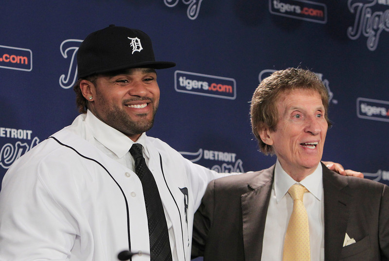 . Prince Fielder stands next to Detroit Tigers team owner Mike Ilitch during his introduction to reporters at a baseball news conference after agreeing to a $214 million, nine-year contract with the Tigers, Thursday, Jan. 26, 2012, at Comerica Park in Detroit. (AP Photo/Carlos Osorio)