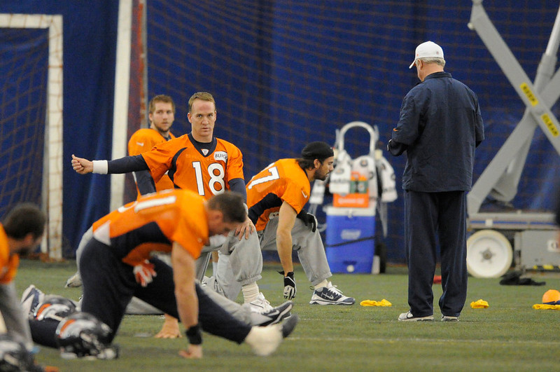 . Denver Broncos quarterback Peyton Manning (18) stretches during practice under the bubble Wednesday, December 19, 2012 at Dove Valley as they prepare for the Cleveland Browns.  John Leyba, The Denver Post
