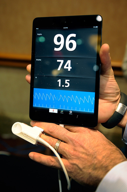 . An iSpO2 pulse oximeter is on display at a press event at the Mandalay Bay Convention Center for the 2013 International CES on January 6, 2013 in Las Vegas, Nevada. The USD 249 personal health monitor attaches to the user\'s mobile device that can record, save and transmit vital statistics. (Photo by David Becker/Getty Images)