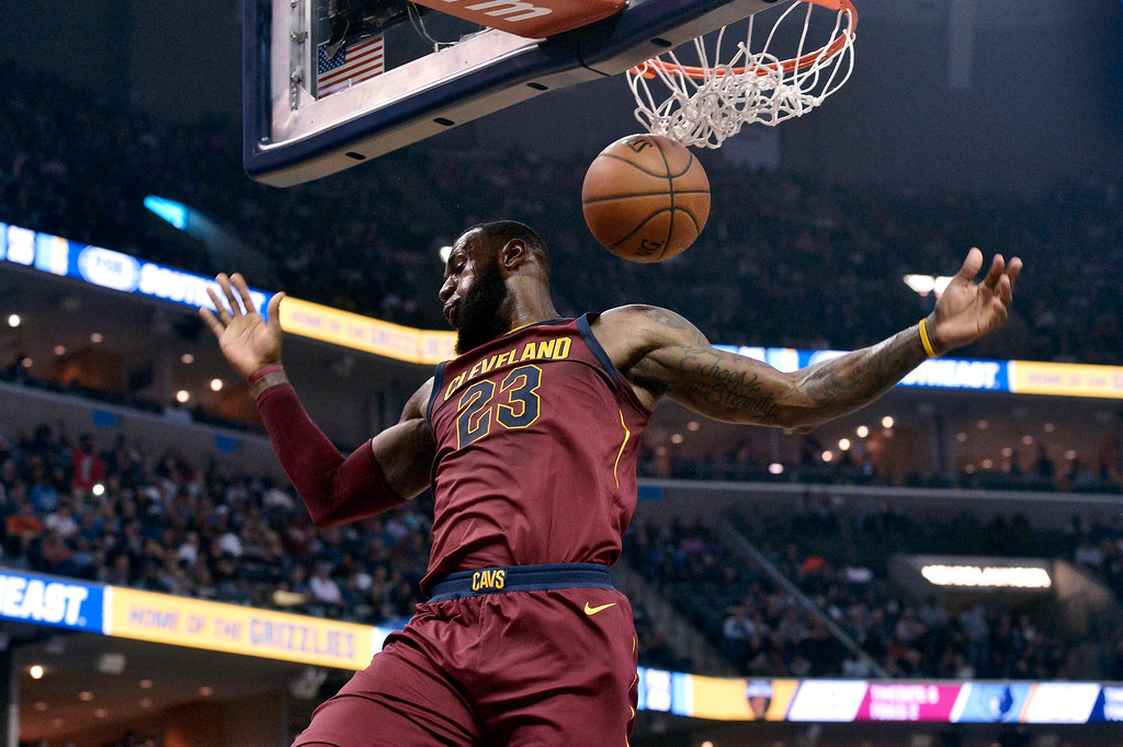 . Cleveland Cavaliers forward LeBron James dunks during the first half of the team\'s NBA basketball game against the Memphis Grizzlies on Friday, Feb. 23, 2018, in Memphis, Tenn. (AP Photo/Brandon Dill)