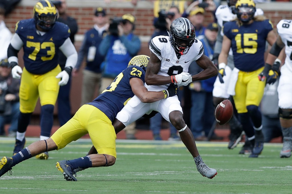 . Michigan defensive back Tyree Kinnel (23) deflects a pass intended for Ohio State wide receiver Binjimen Victor (9) during the first half of an NCAA college football game, Saturday, Nov. 25, 2017, in Ann Arbor, Mich. (AP Photo/Carlos Osorio)