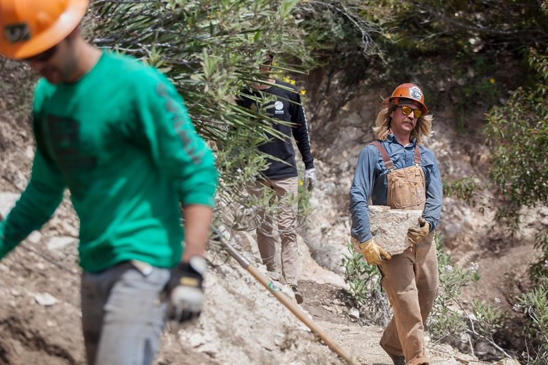 LA CANADA, CA -  April 15, 2018:     (R) Matt Baffert, 37, carpenter and the trail boss for the Mt. Wilson Bicycling Association, works along other volunteers who had joined him to work on armoring a drainage to parts of the Gabrielino Trail, on Sunday, Apr. 15, 2018, to manage water flow and minimize erosion on the final stretches of the wilderness trail, between Bear Canyon and Oakwilde camp ground in the Western San Gabriel Mountains.  A 10-mile stretch of the historic Gabrielino Trail cutting across the rugged heart of the San Gabriel Mountains has been closed for nearly a decade due to damage caused by the Station Fire in 2009. It is now set to open this summer, after undergoing laborious restoration at the hands of the volunteers who met monthly for the past 9 years to repair the wilderness trail and to restore it back to the forest service standards.  (Photo / Silvia Razgova)  Assign Name: 3044061_la-me-gabrielino-trail