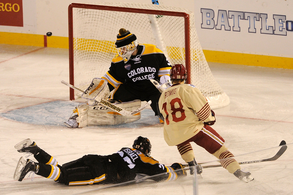 . Colorado College goalie Jacob Nehama (31) deflects a shot by Emil Romig (18) of the University of Denver as Ben Israel (27) dives to block the shot during the third period at Coors Field in Denver, Colorado on February 20, 2016. (Photo by Seth McConnell/The Denver Post)