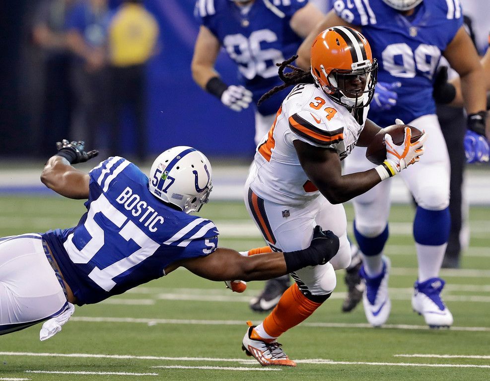 . Cleveland Browns running back Isaiah Crowell (34) is tackled by Indianapolis Colts inside linebacker Jon Bostic (57) during the first half of an NFL football game in Indianapolis, Sunday, Sept. 24, 2017. (AP Photo/Darron Cummings)
