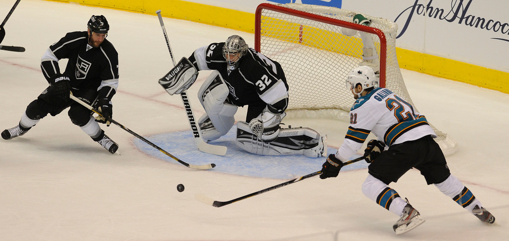 . Kings#10 Mike Richards and Kings#32 Jonathan Quick stop a puck by Sharks#21 JT Galiardi in the first period. The Kings played the San Jose Sharks during the first game in the Second Round of the Western Conference Playoffs. Los Angeles CA 5/14/2013(John McCoy/LA Daily News)