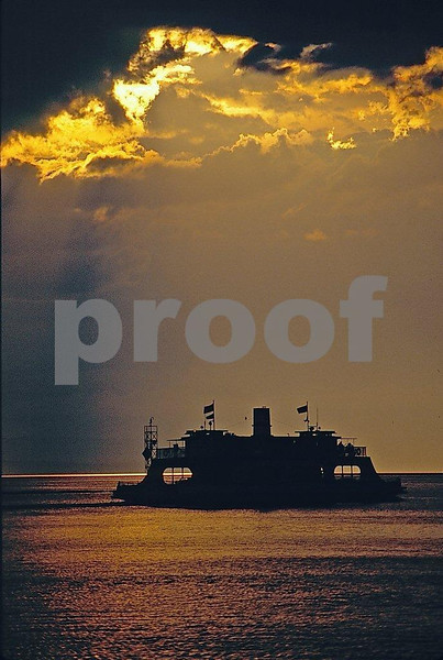 The ferry at sunset making its way across lake Champlain.