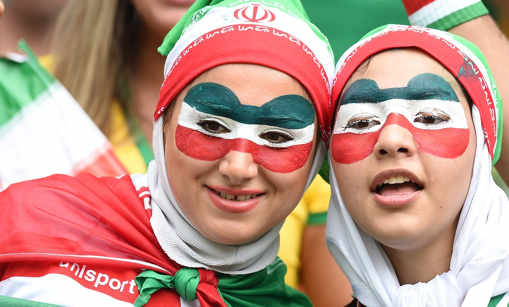 . Fans of Iran smile during a Group F football match between Bosnia-Hercegovina and Iran at the Fonte Nova Arena in Salvador during the 2014 FIFA World Cup on June 25, 2014.     AFP PHOTO / JAVIER SORIANO/AFP/Getty Images