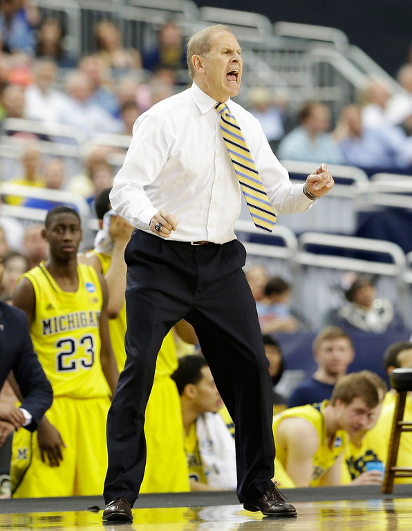 . Michigan head coach John Beilein reacts against Michigan during the first half of a regional final game in the NCAA college basketball tournament, Sunday, March 31, 2013, in Arlington, Texas. (AP Photo/David J. Phillip)
