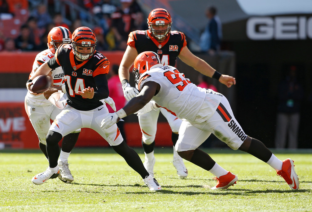 . Cincinnati Bengals quarterback Andy Dalton (14) scrabbles against Cleveland Browns defensive tackle Trevon Coley (93) in the second half of an NFL football game, Sunday, Oct. 1, 2017, in Cleveland. (AP Photo/Ron Schwane)