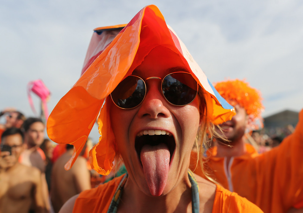 . A Dutch soccer fan celebrates her team\'s victory after she watched the World Cup round of 16 match against Mexico on a live telecast inside the FIFA Fan Fest area on Copacabana beach in Rio de Janeiro, Brazil, Sunday, June 29, 2014. The Netherlands staged a dramatic late comeback, scoring two goals in the dying minutes to beat Mexico 2-1 and advance to the World Cup quarterfinals. (AP Photo/Leo Correa)