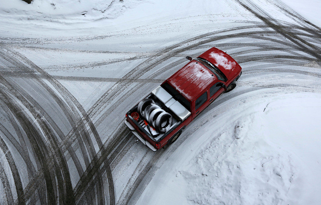 . The driver of a pickup appears to have swapped out his general use tires (in the truck\'s bed) in favor of snow tires just in time to deal with the snow-covered streets if Auburn, Maine, Thursday, Dec. 29, 2016. A nor\'easter is expected to drop 12 to 18 inches of snow on parts of Maine, according to the National Weather Service. (AP Photo/Robert F. Bukaty)