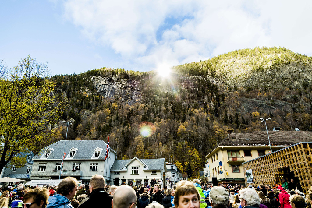 . People gather during the official opening of giant sun mirrors in the town of Rjukan, Norway, on October 30, 2013. Residents of a remote village nestled in a steep-sided valley in southern Norway are about to enjoy winter sunlight for the first time ever thanks to giant mirrors.  AFP PHOTO / KRISTER Soerboe/AFP/Getty Images