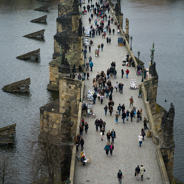 Tourists walking on Charles Bridge viewed from Old Town Bridge Tower, Prague, Czech Republic