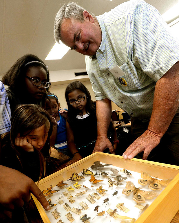 . Entomologist Tim Hayes shows students a box of insects and butterflies during the final day of the 19th Annual Career Awareness Week at Lankershim Elementary School in Highland June 6, 2013.  GABRIEL LUIS ACOSTA/STAFF PHOTOGRAPHER.