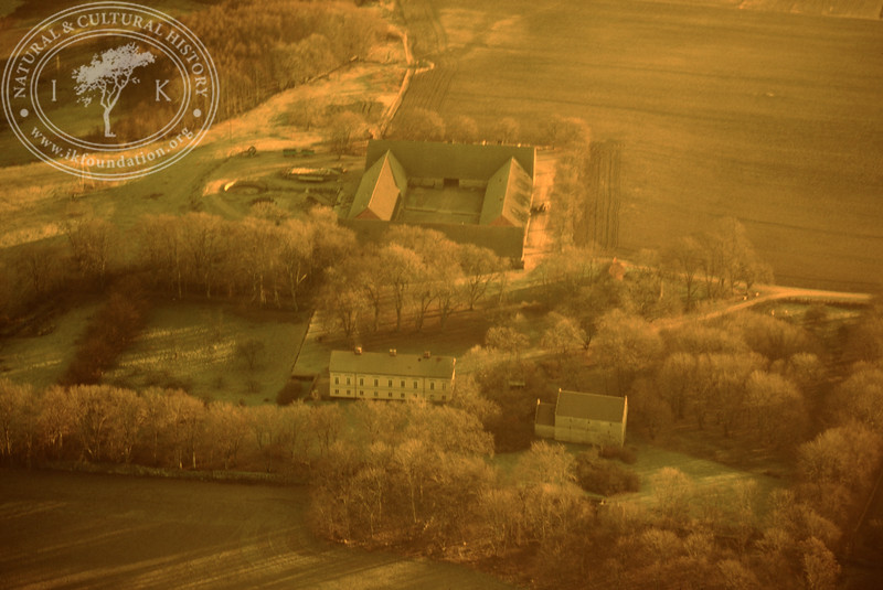 Araslöv manor house and church with farmland. Experimentally photographed with yellow filter (19 November, 1988). | LH.0232
