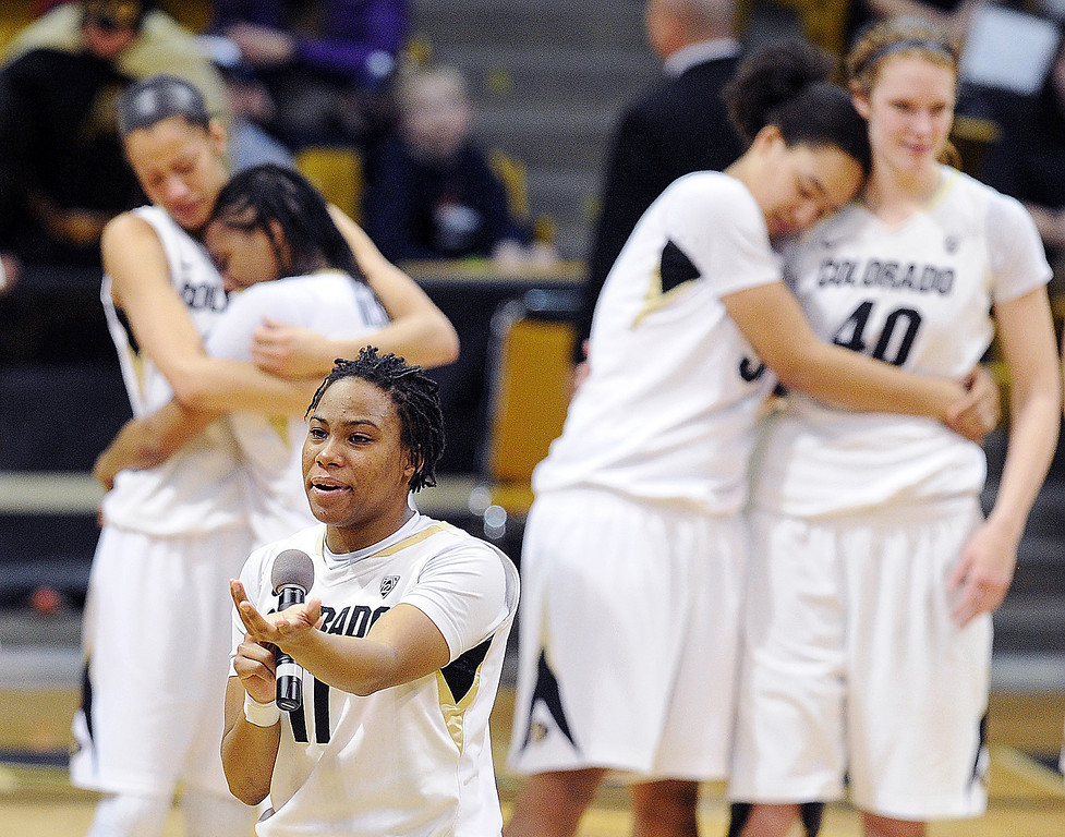 . Brittany Wilson gets emotional, as do her teammates in the background,  while saying good bye to the fans. (Class Grassmick/Daily Camera)