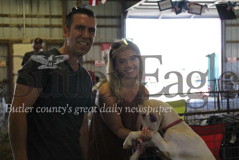 Greg Mandalas of Butler and his daughter, Abby, with a goat at the Big Butler Fair's petting zoo on July 7, 2018.