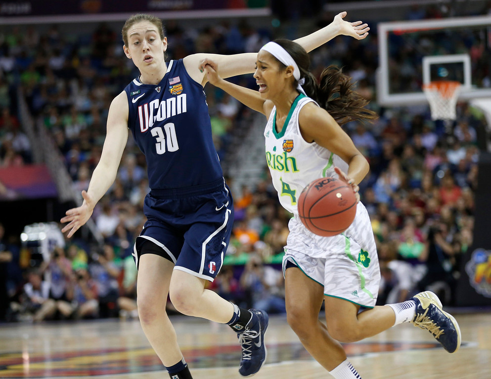 . Notre Dame guard Skylar Diggins (4) drives against Connecticut forward Breanna Stewart (30) in the first half of the women\'s NCAA Final Four college basketball tournament semifinal, Sunday, April 7, 2013, in New Orleans. (AP Photo/Dave Martin)