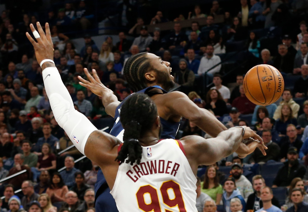 . Minnesota Timberwolves\' Andrew Wiggins reacts as he is fouled by Cleveland Cavaliers\' Jae Crowder, left, in the first half of an NBA basketball game Monday, Jan. 8, 2018, in Minneapolis. (AP Photo/Jim Mone)