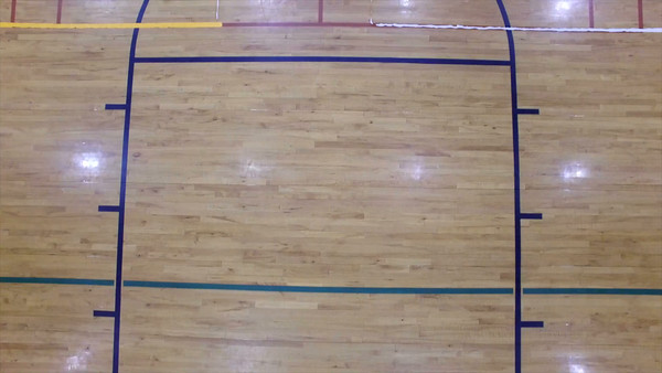 Aerial flying over indoor basketball court