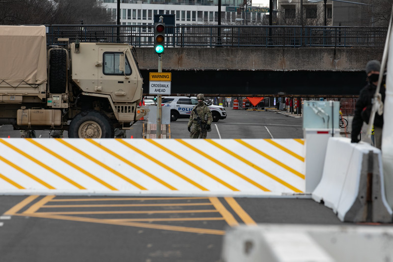 A National Guard troop stands at a checkpoint near the U.S. Capitol