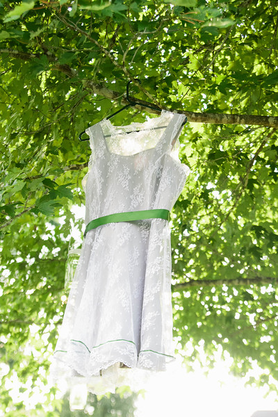 short wedding dress hanging in tree
