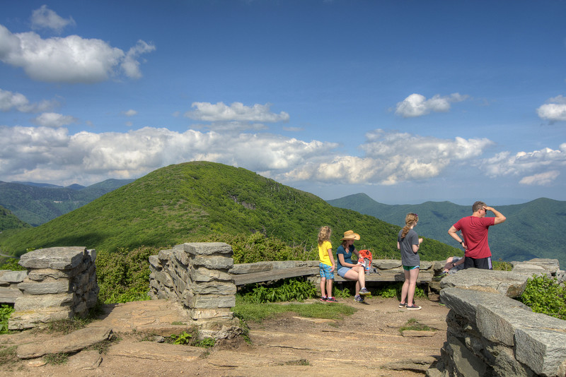 Visitors enjoy the view from an observation area at the Craggy Gardens Overlook at Milepost 364 on the Blue Ridge Parkway in NC on Saturday, June 15, 2013. Copyright 2013 Jason Barnette